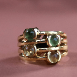 a stunning ring with 4 stones and an intricate design
