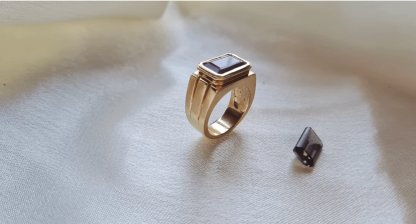 latest handmade jewellery from gemma rose a gold ring stood next to a smokey stone